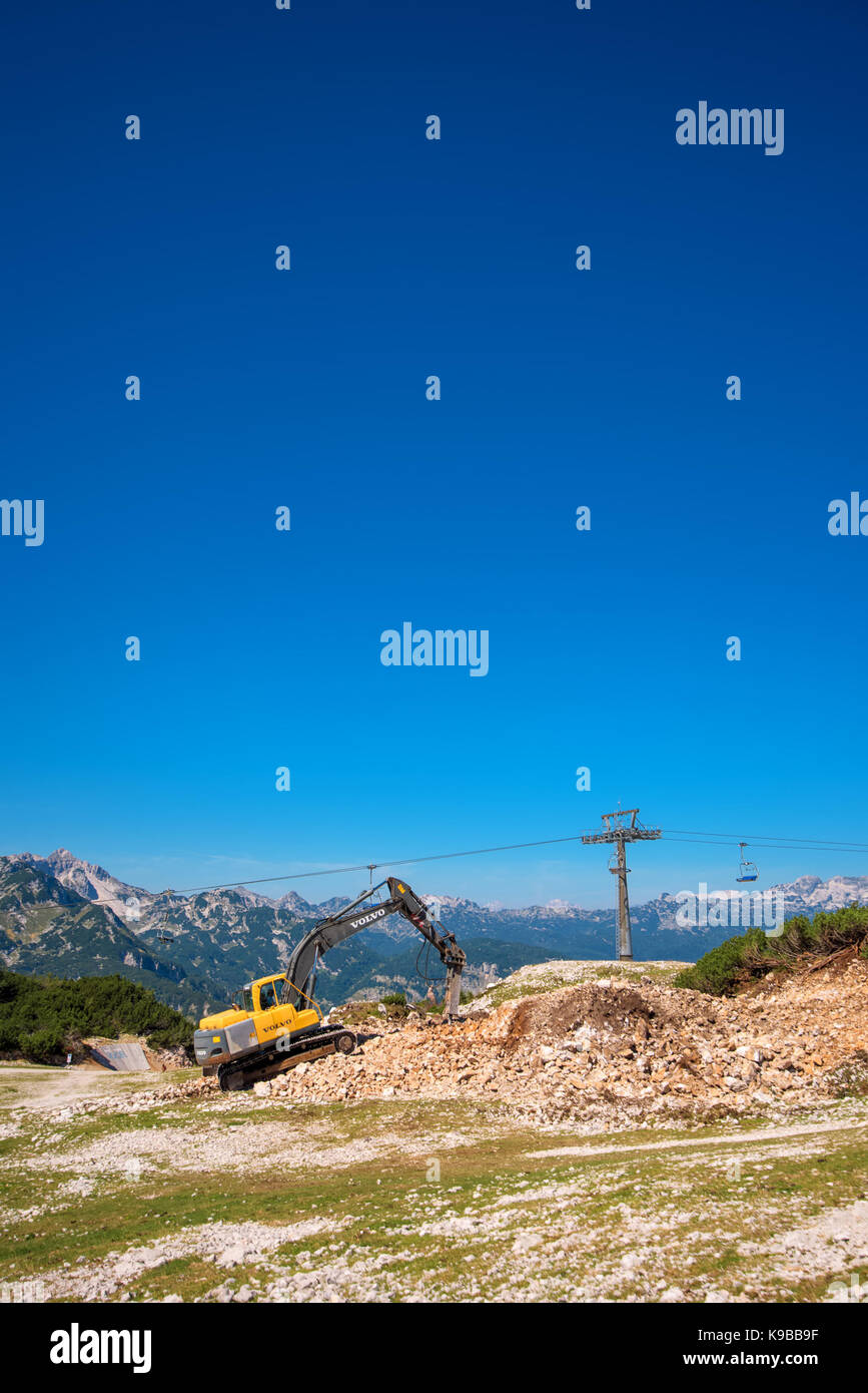 VOGEL MOUNTAIN, SLOVENIA - AUGUST 30, 2017: Construction machinery for crushing stone, Volvo bulldozer working on - Stock Image