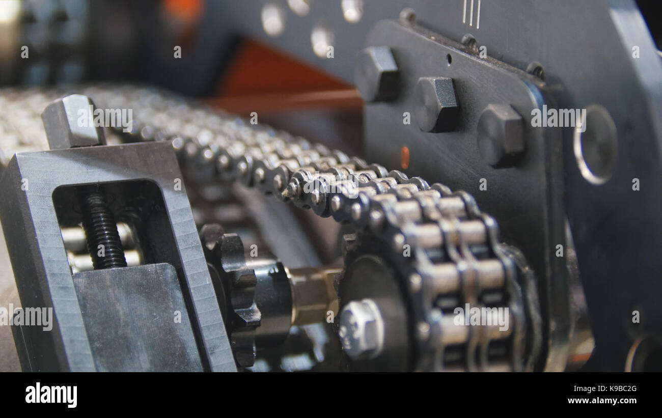 Caterpillar transmission - mechanism of machinery manufacturing on extrusion plant - chemistry industry - Stock Image