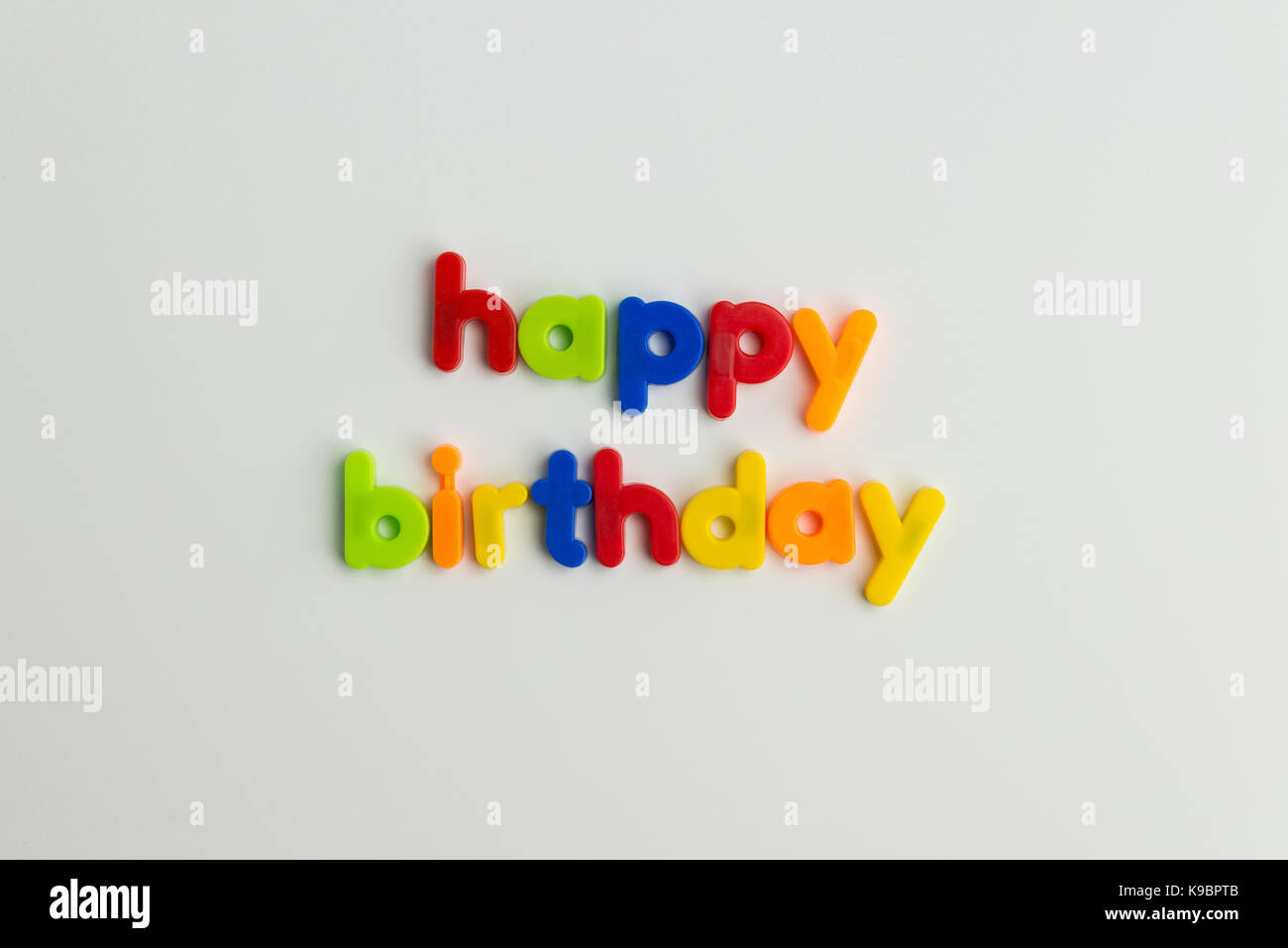 happy birthday words in colourful children's letters Stock Photo