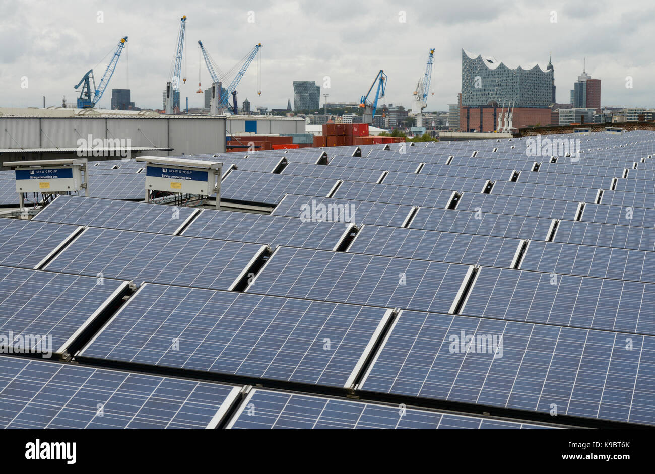 GERMANY, Hamburg, concert hall Elbphilharmonie and solar panel on roof of store-house in harbour / DEUTSCHLAND, - Stock Image
