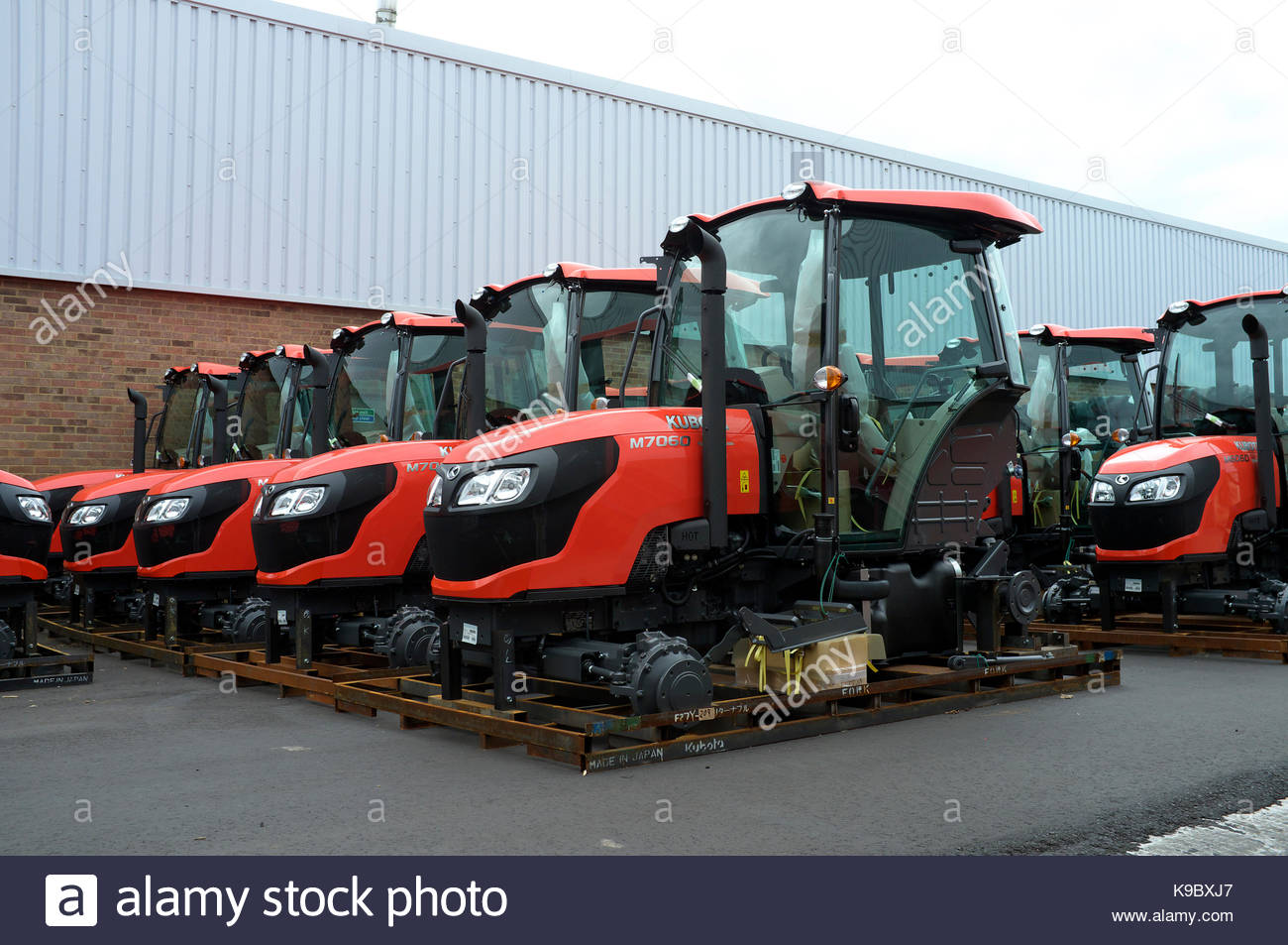 New Kubota tractors after import, awaiting preparation for distribution to customers. Thame, Oxfordshire, UK. - Stock Image