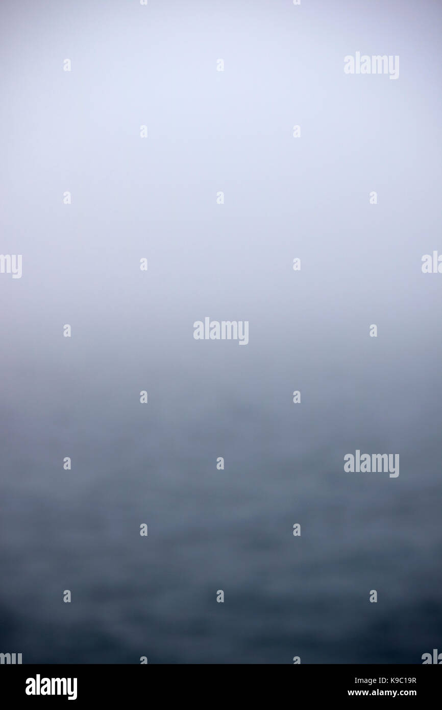 unclear deliberate blur of foggy day at sea - Stock Image