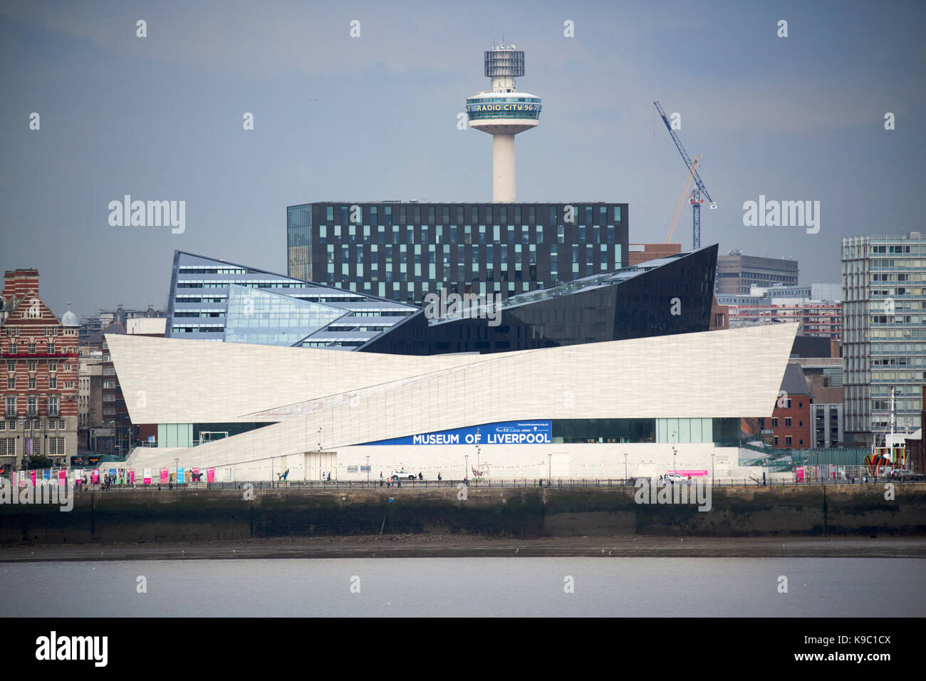 museum of liverpool on river mersey waterfront and liverpool skyline - Stock Image