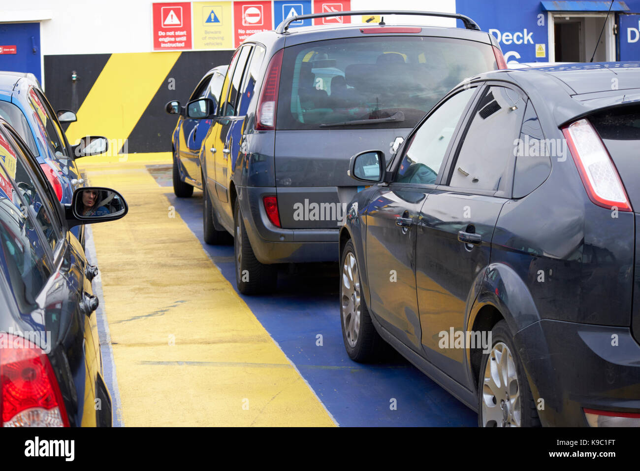 cars parked on upper open vehicle deck on top of stena line vehicle ferry on the irish sea - Stock Image