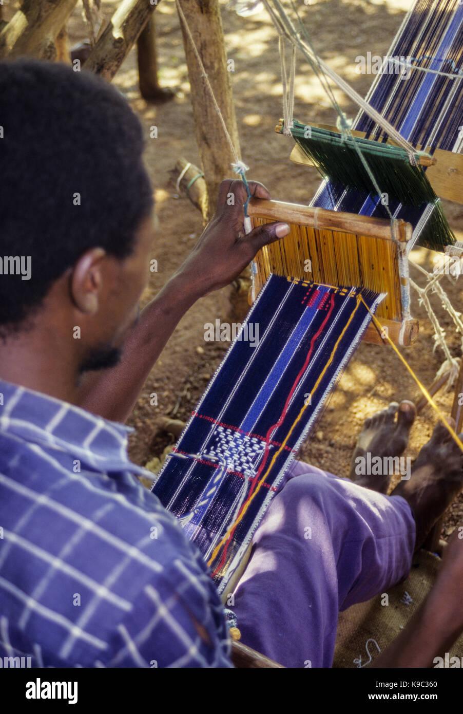 Korhogo, Ivory Coast, Cote d'Ivoire.  Senoufo Male Weaver at Work. - Stock Image