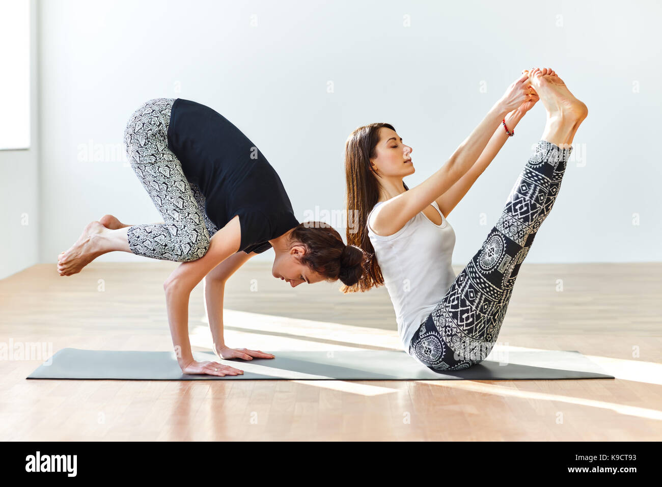 Two Young Women Practicing Yoga Poses And Asanas Partner Yoga Stock Photo Alamy