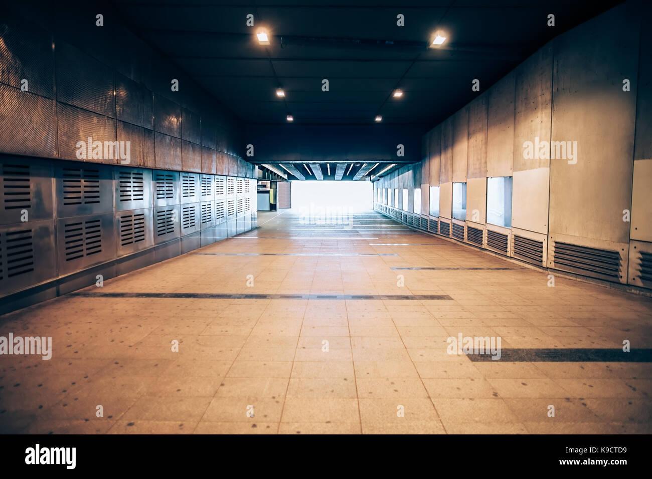 Exit from the underground metro. Long corridor - Stock Image
