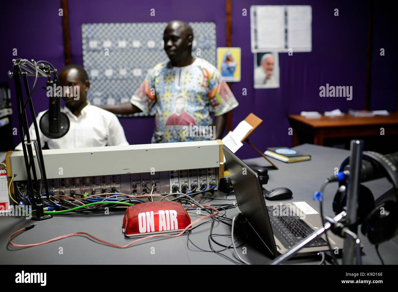 UGANDA, Arua, Radio Pacis, on air, live broadcasting studio, Station Manager Gaetano Apamaku - Stock Image