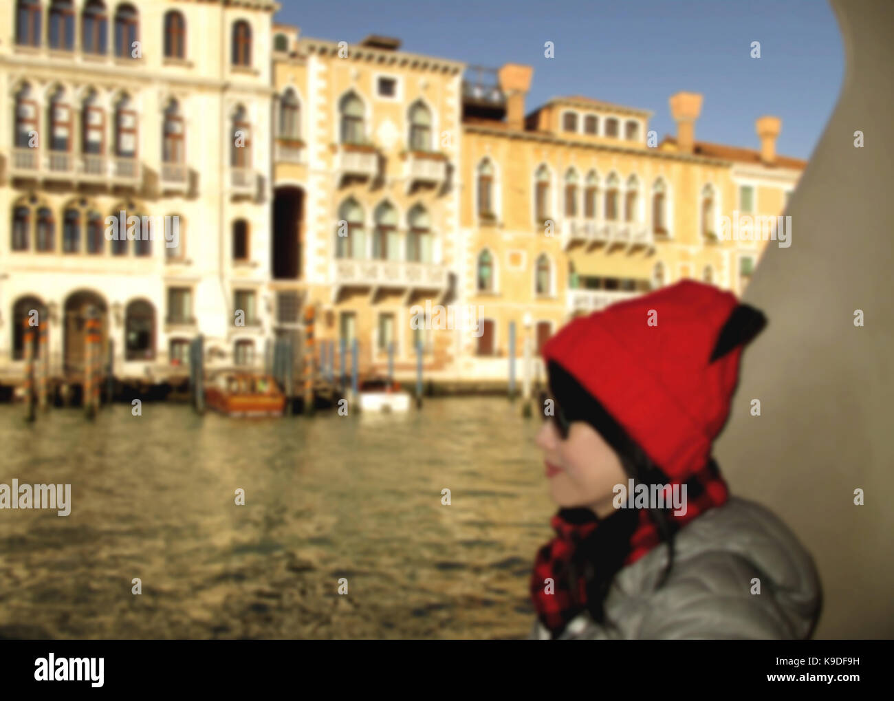 Abstract blurred of a female tourist enjoy cruising the Grand Canal of Venice on the winter day - Stock Image