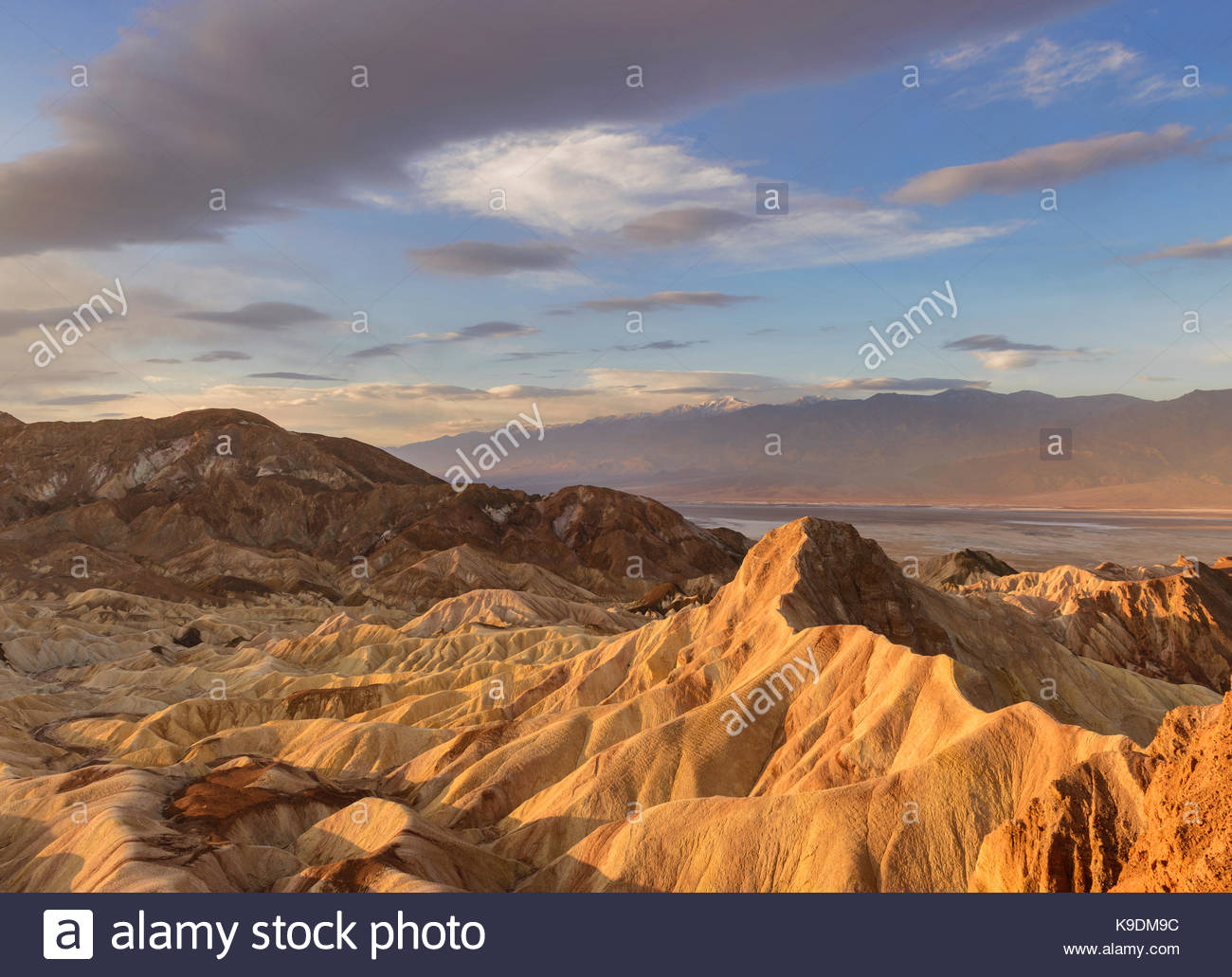 Manley Beacon and Clouds at Dawn from Zabriskie Point, Death Valley National Park, California - Stock Image