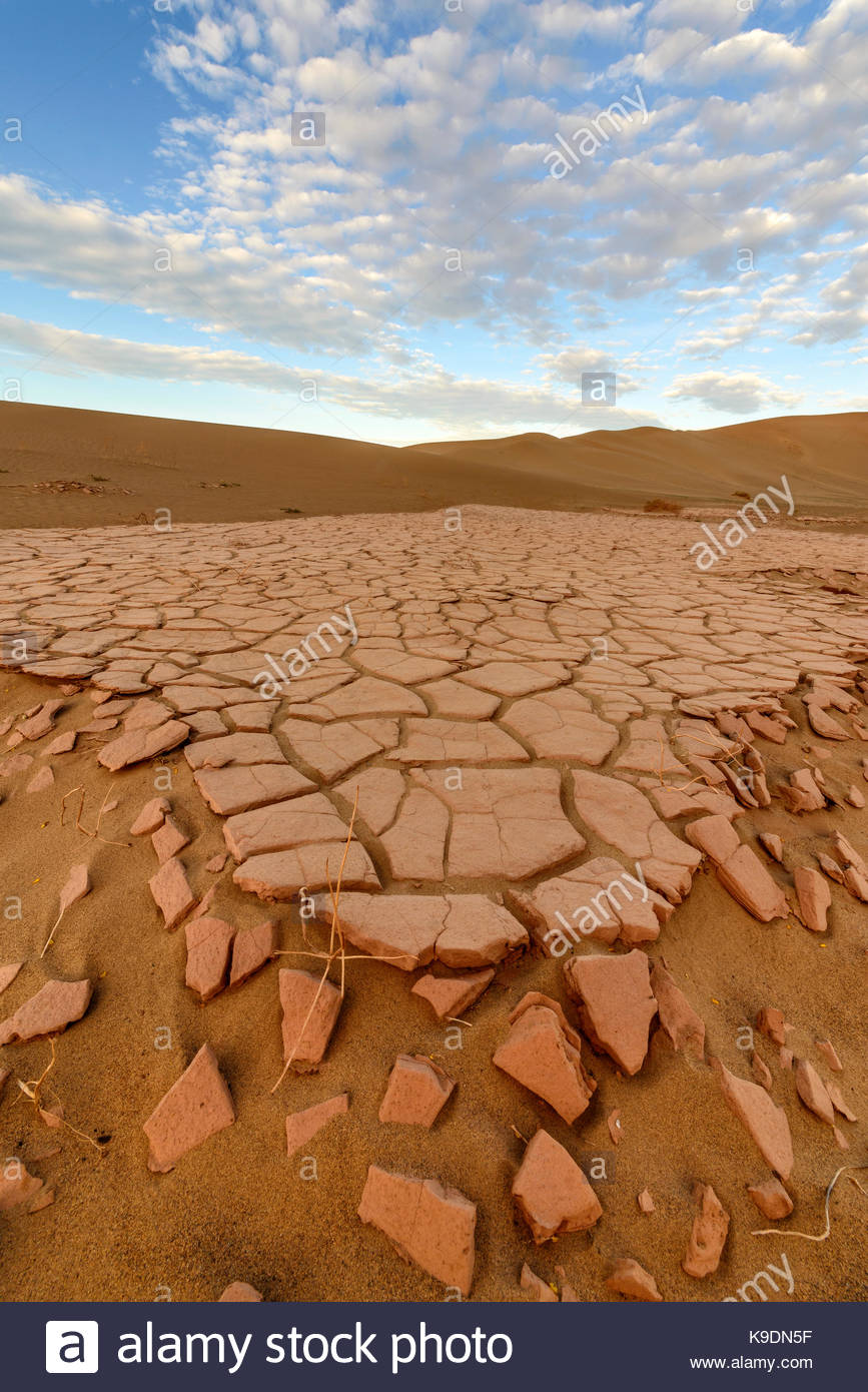 Crumbling Lakebed Playa, and Clouds Death Valley National Park, California - Stock Image