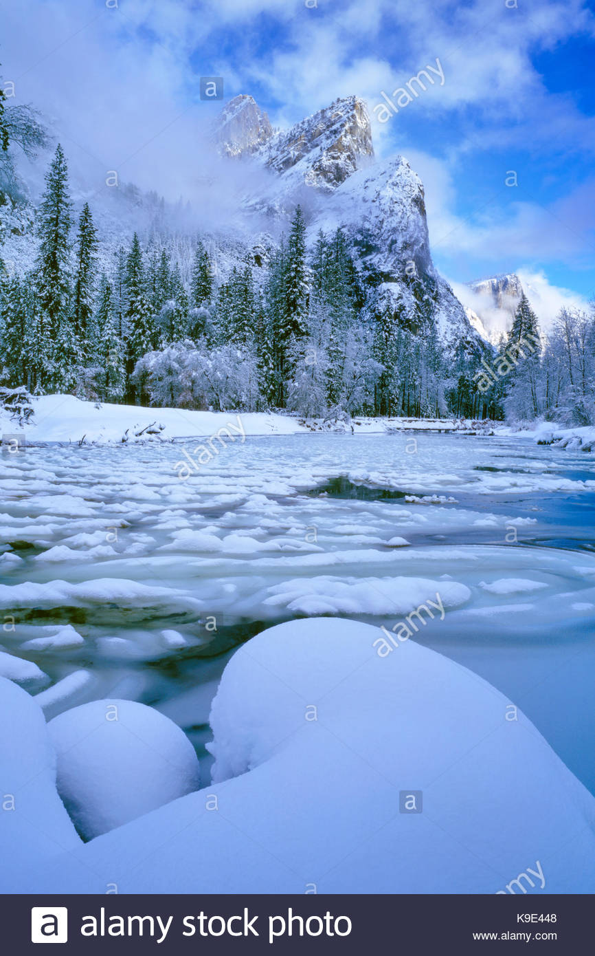 Snow Forms and the Merced River below the Three Brothers, Yosemite National Park, California - Stock Image