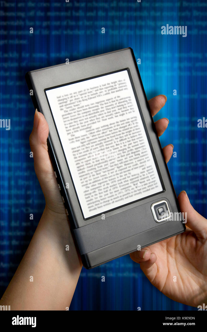 woman hands holding an e-book reader - Stock Image