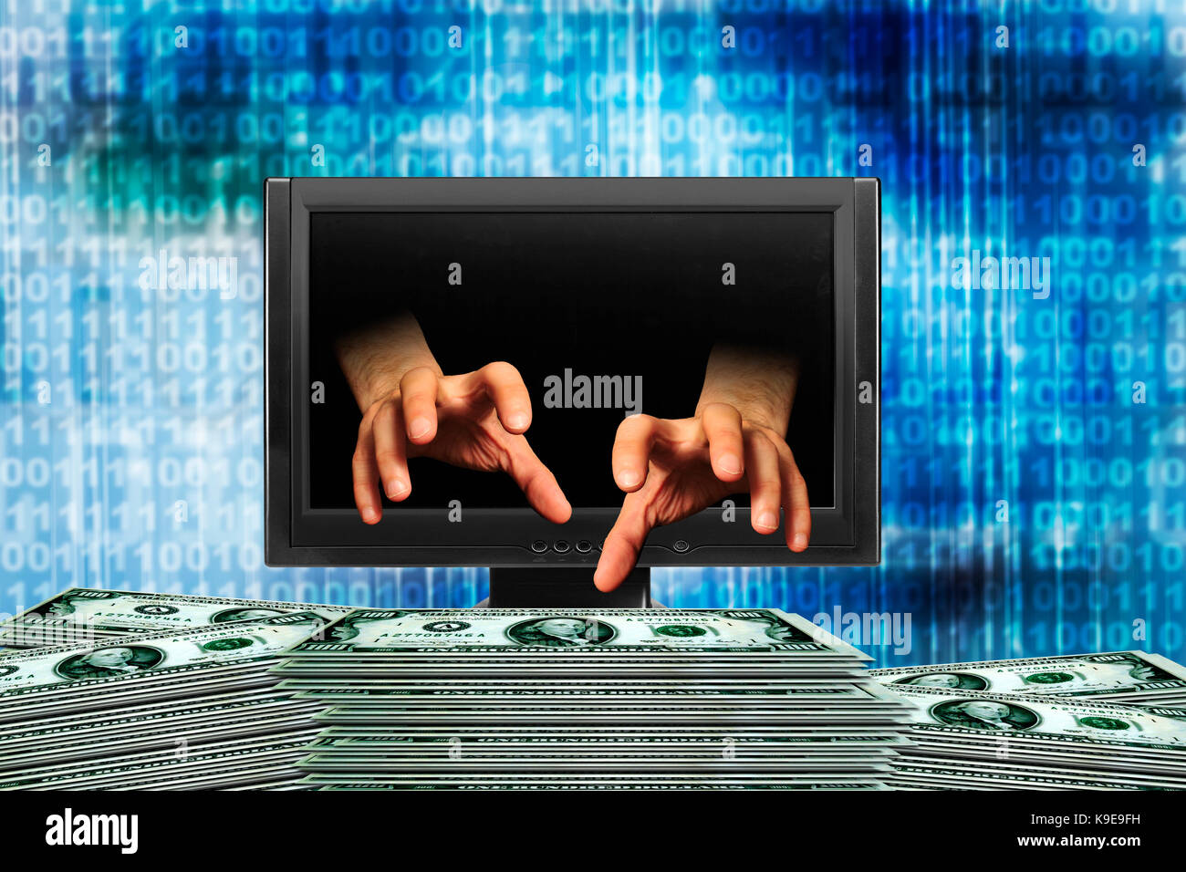 hands coming out of a computer monitor grabbing money, internet fraud or crime - Stock Image