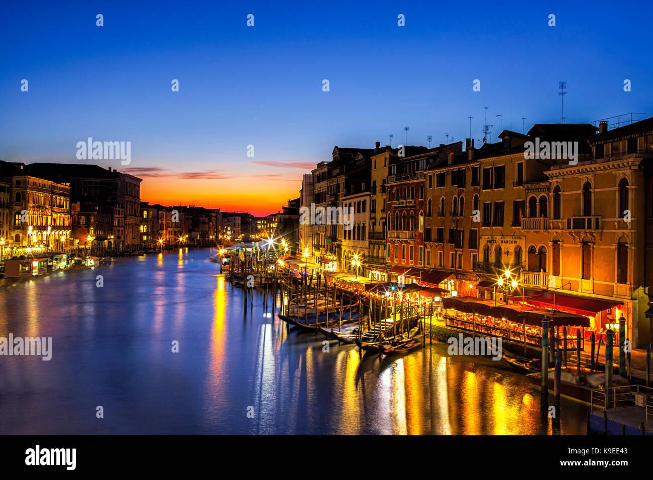 Twilight scene from the Rialto Bridge in Venice, Italy - Stock Image
