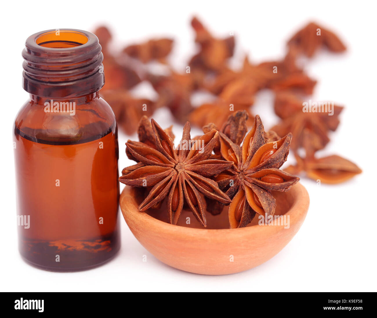 Some aromatic cinnamon with star anise and essential oil in a bottle - Stock Image