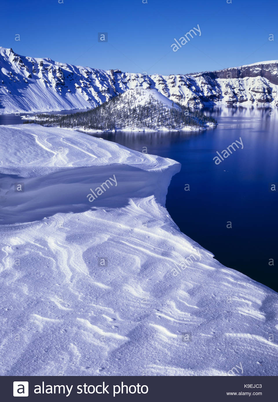 Snow Cornice and Wizard Island, Crater Lake National Park, Oregon - Stock Image