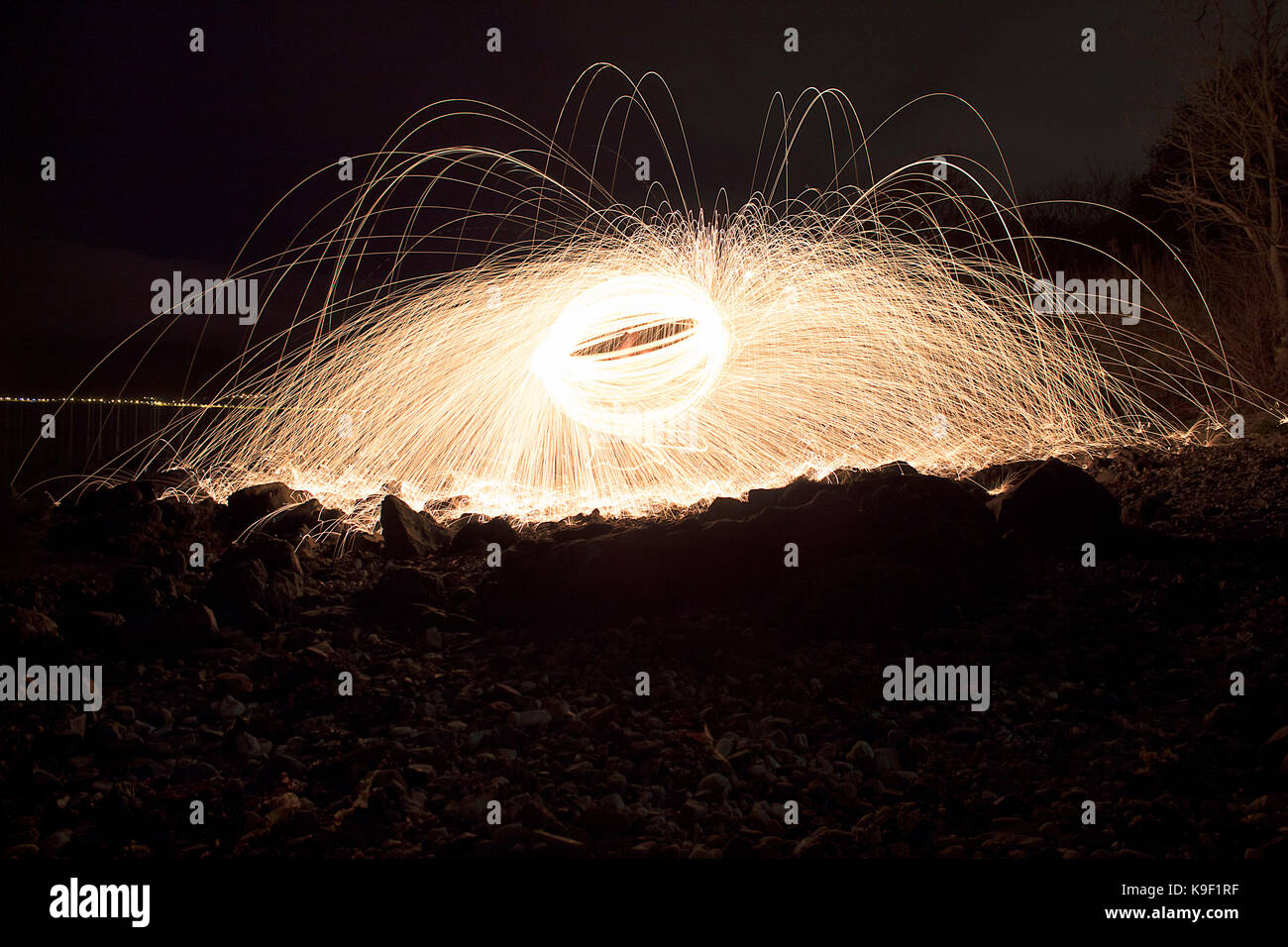 Fire ball. Light painting with steel wool spinning Stock Photo