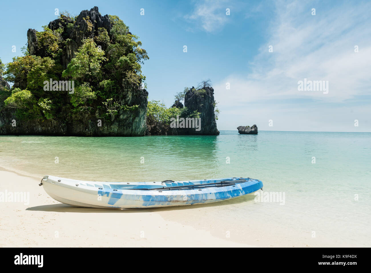 Blue kayaks on the tropical beach in Phuket, Thailand. Summer, Vacation and Travel concept. - Stock Image