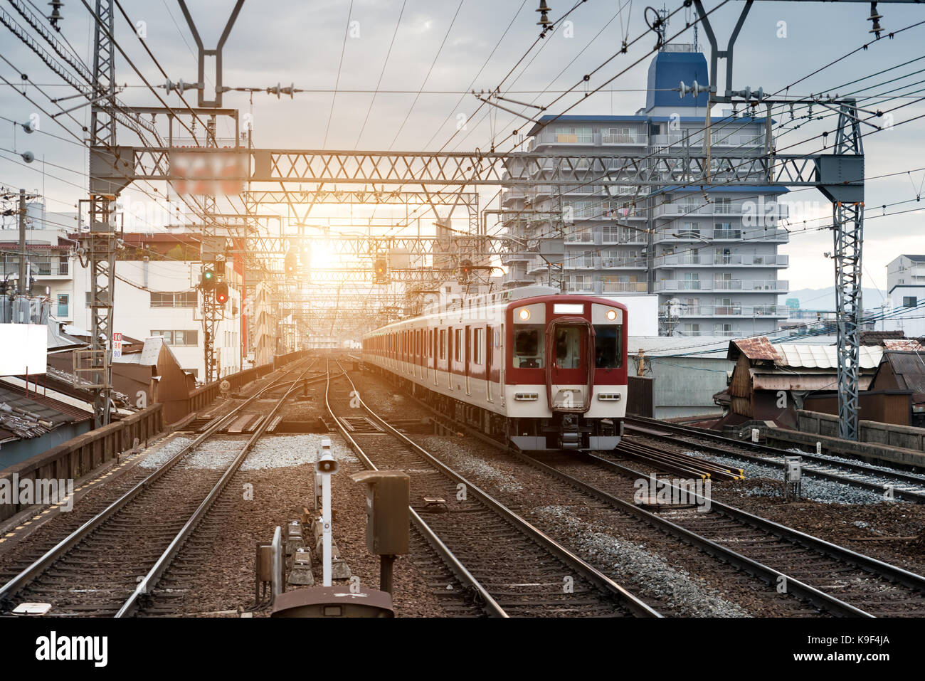 Japan train on railway with skyline at Osaka, Japan for transportation background - Stock Image