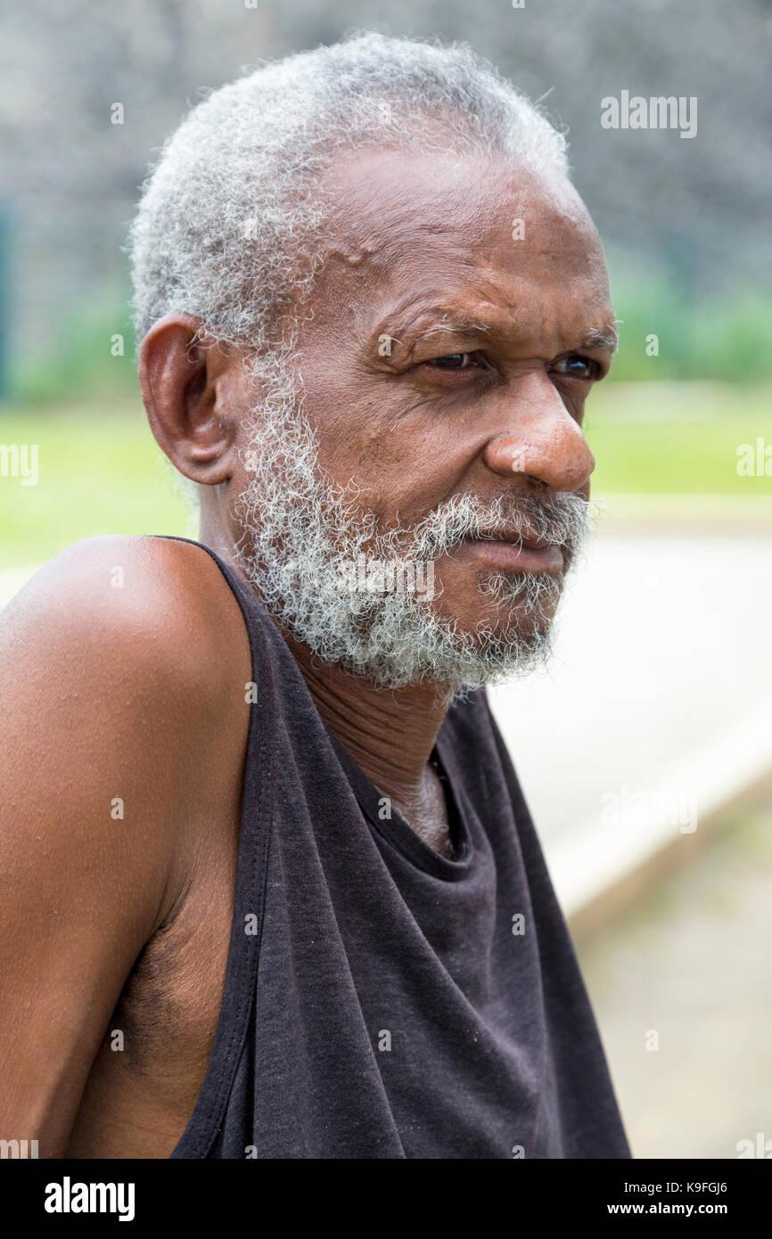 Fort-de-France, Martinique.  Elderly Man Resting on a Park Bench. - Stock Image