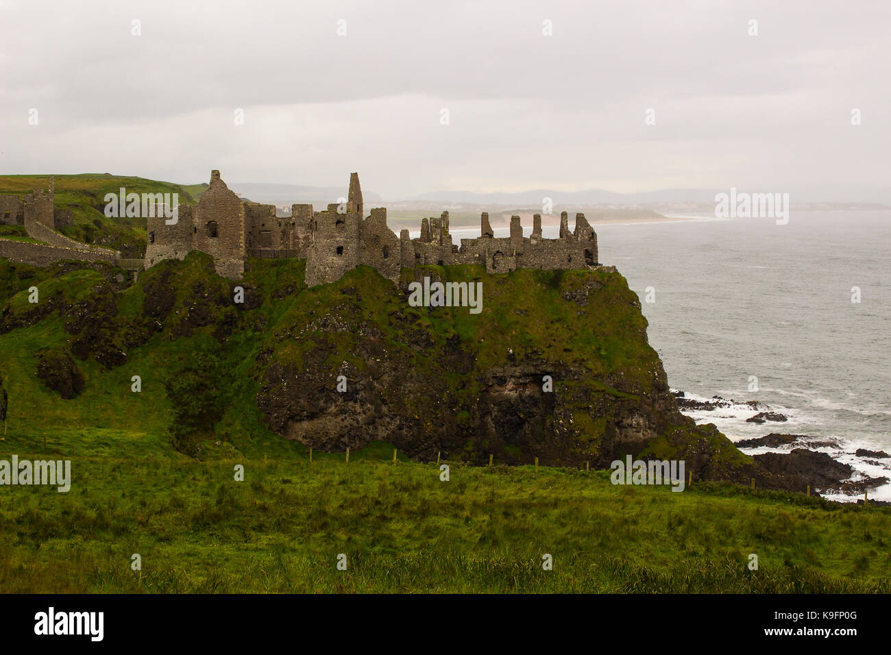 The historic Dunluce Castle ruins near Bushmills on the North Antrim coast in Northern Ireland often used as a film - Stock Image
