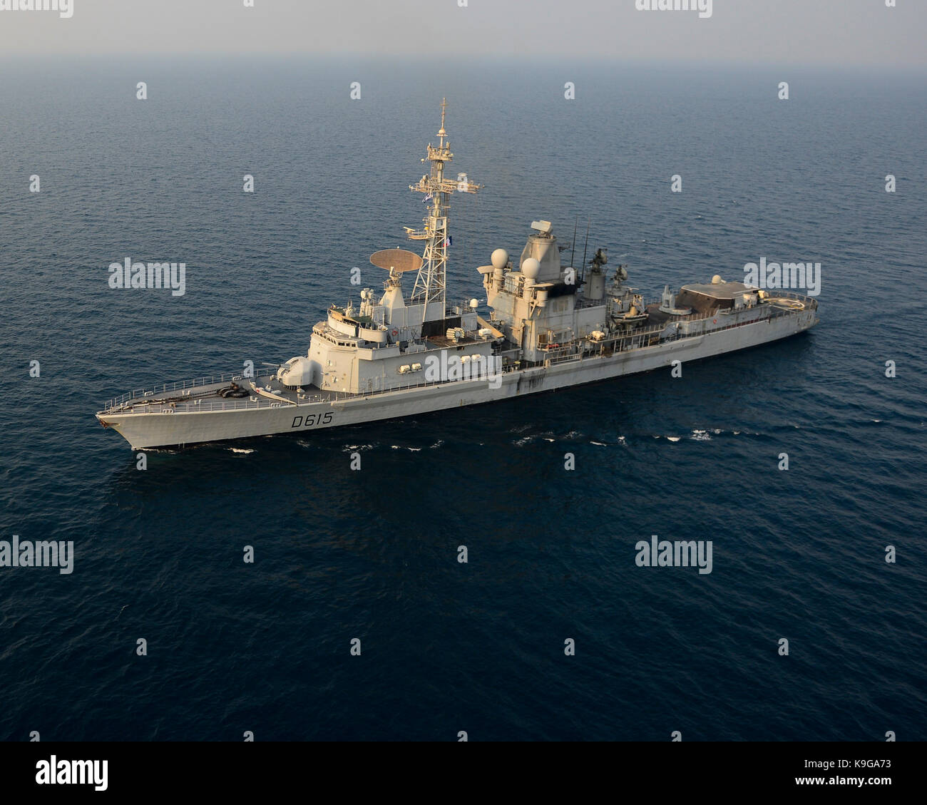 The French navy air defense destroyer FS Jean Bart (D615) transits the Arabian Gulf. - Stock Image