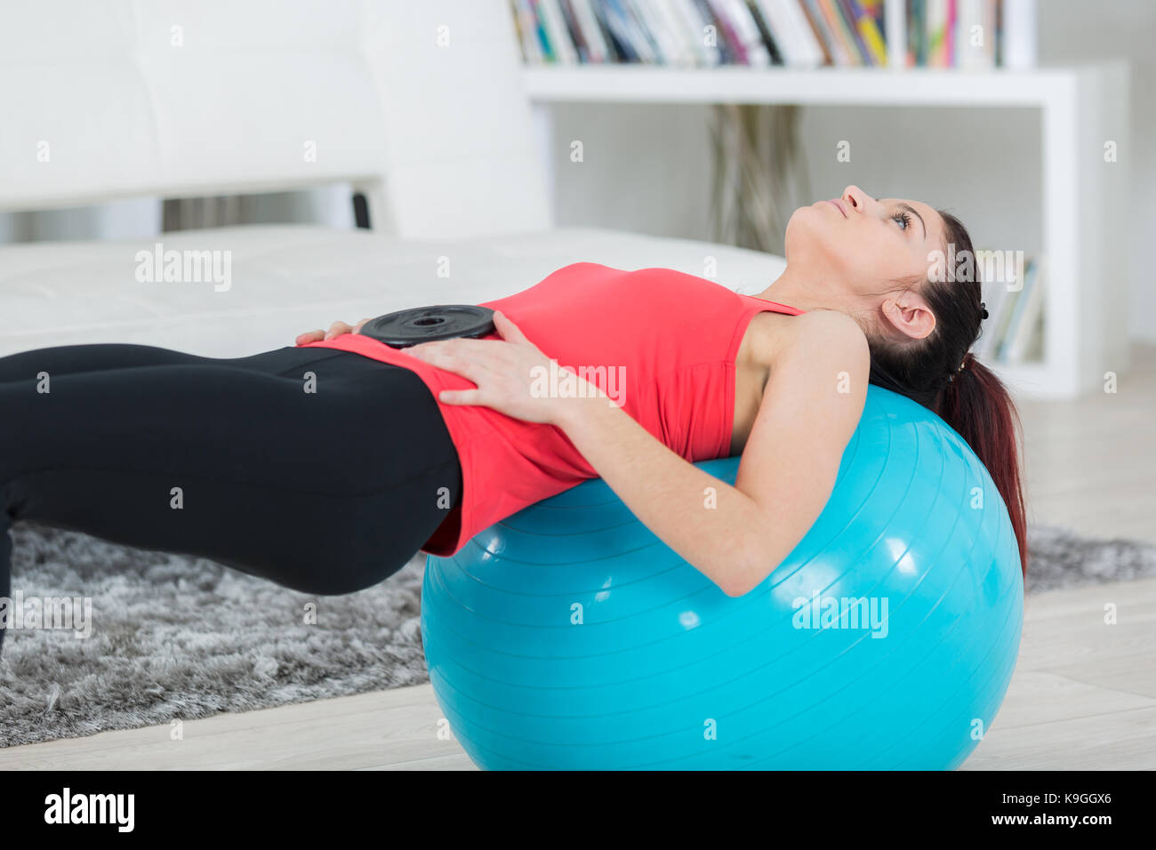 Fitness Girl Doing Crunches Lying On The Floor At Home Stock Photo