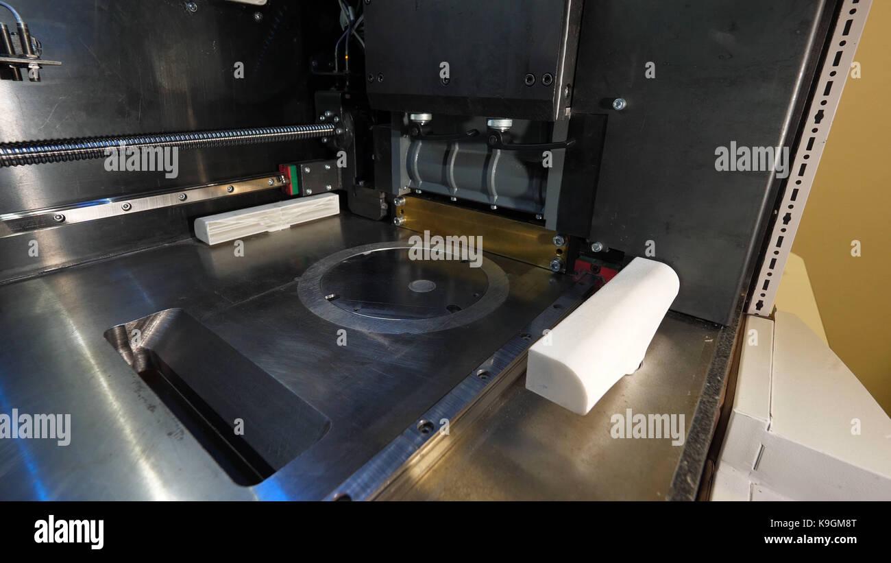 Modern 3D printer printing figure close-up macro. Automatic three dimensional 3d printer in laboratory - Stock Image