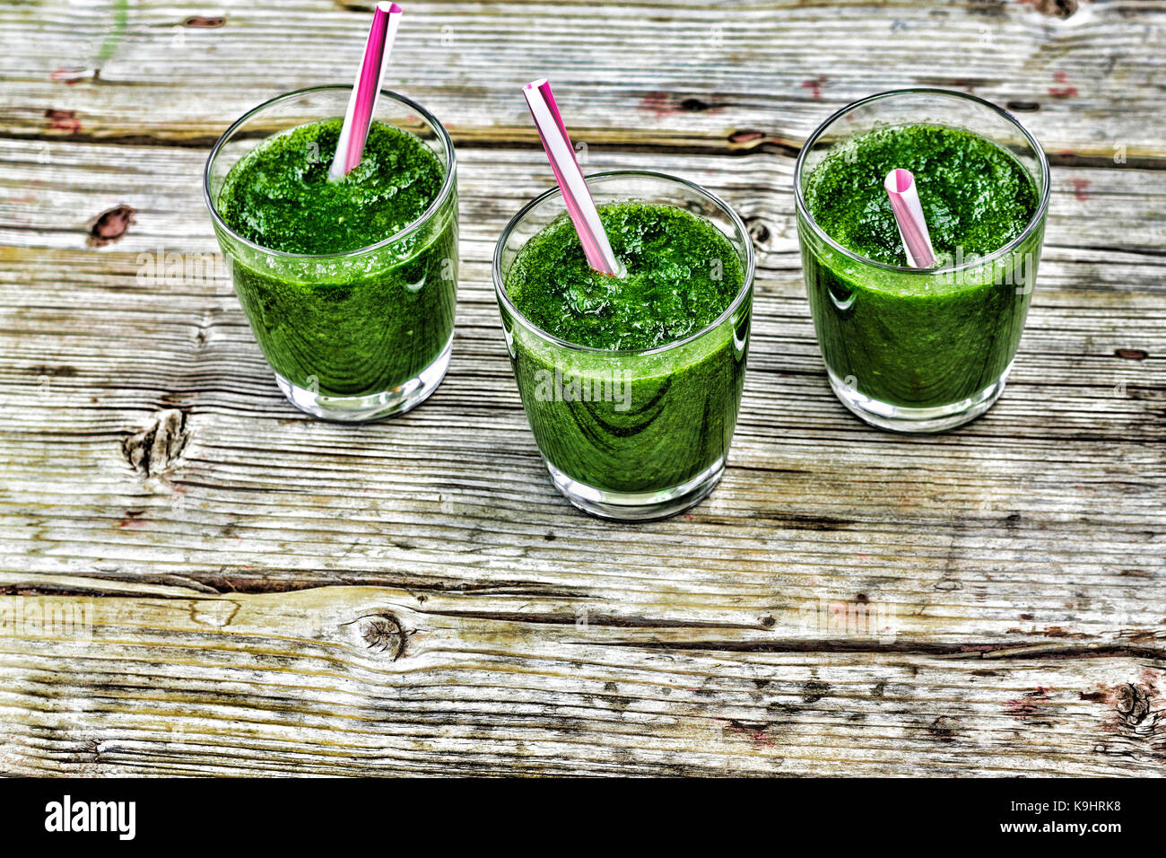 Detox drink from spinach and various green vegetables wooden background Stock Photo