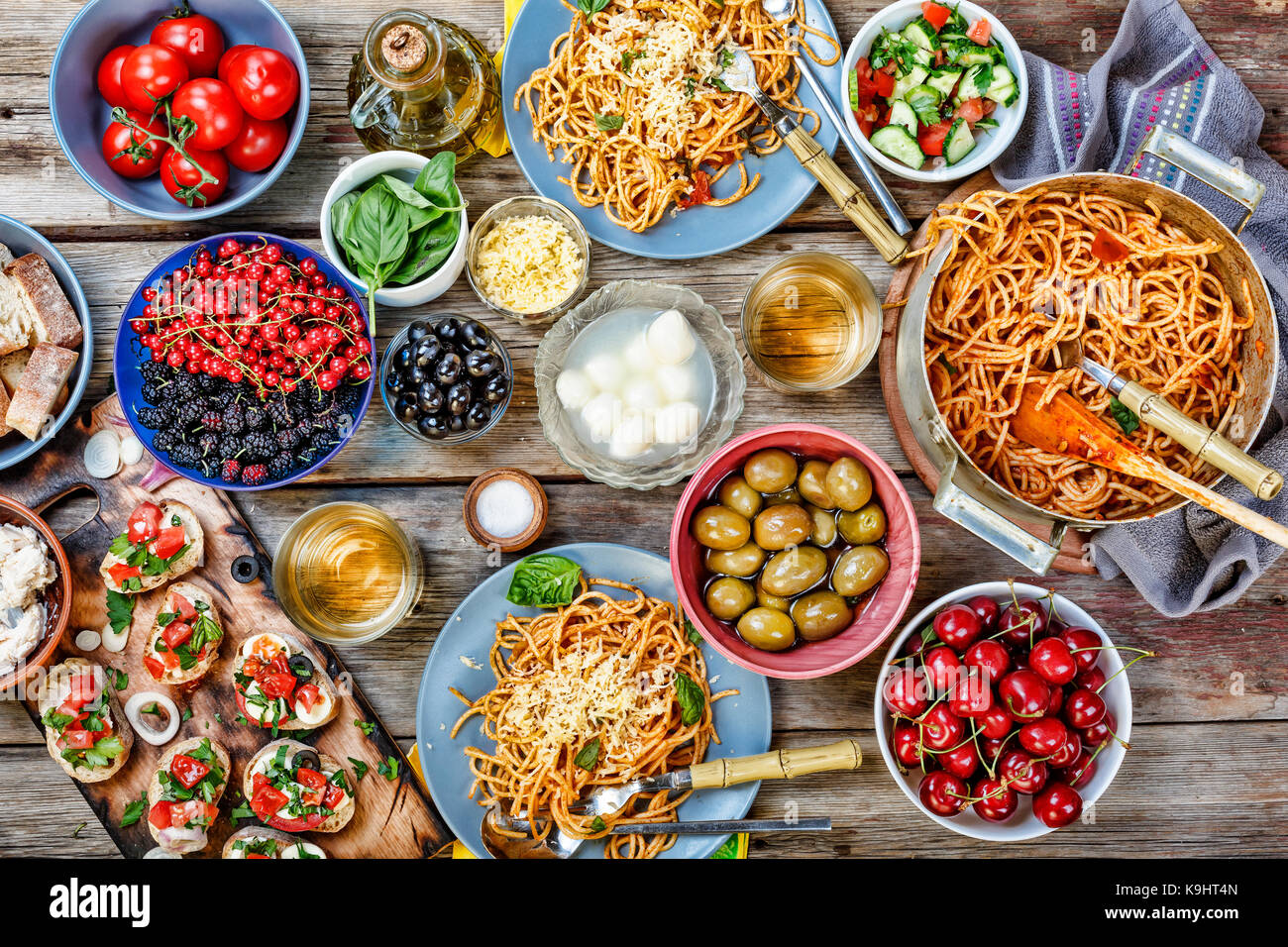 Various Asian and European snacks at dinner table top view The