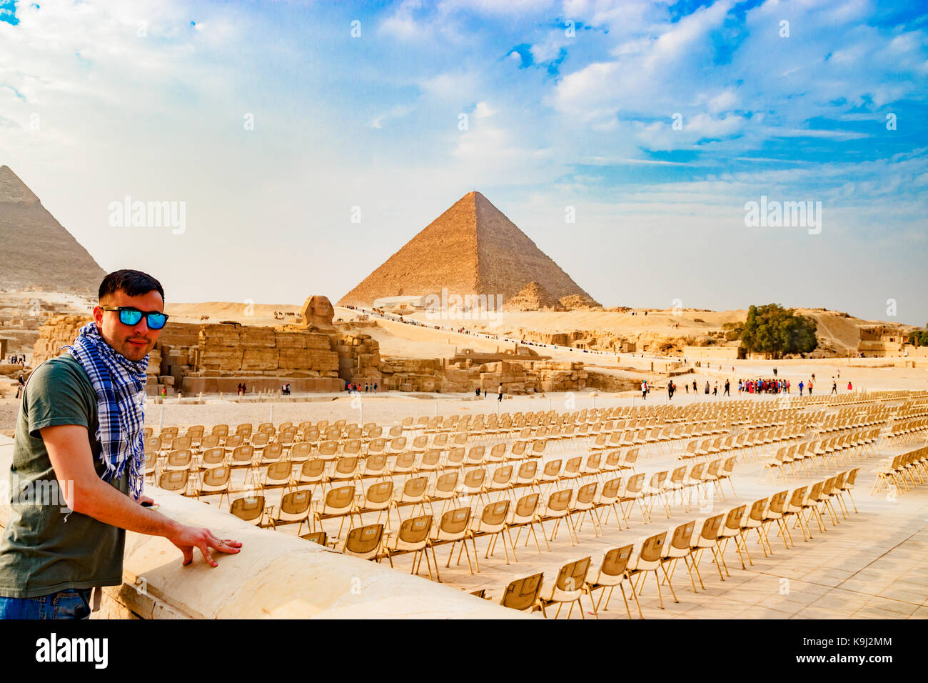 Looking at chairs near the pyramid in Cairo, Egypt - Stock Image