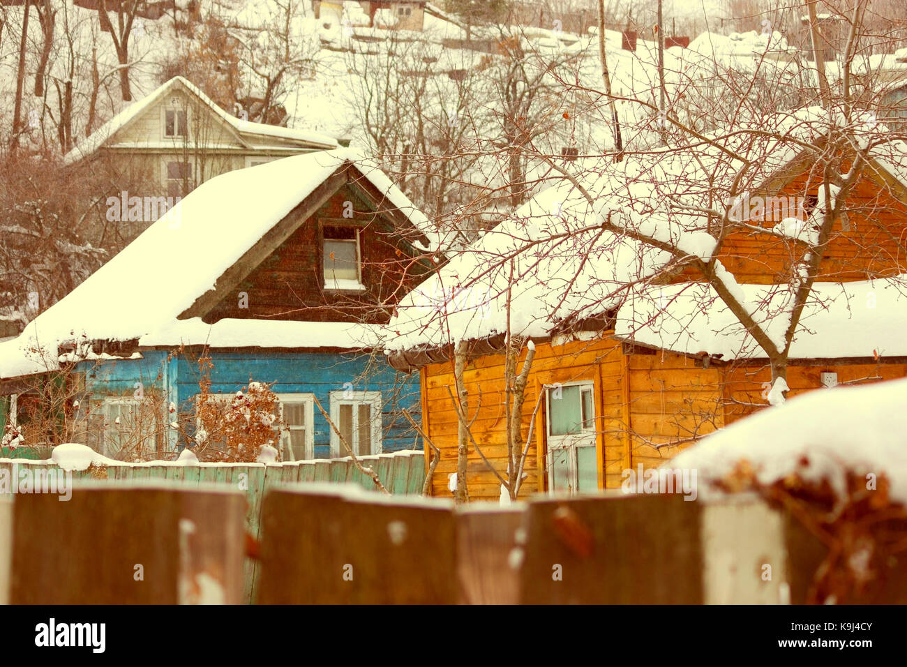 Snow house in winter dreamland at dawn in forest old weather and a lot of snow on roof Stock Photo