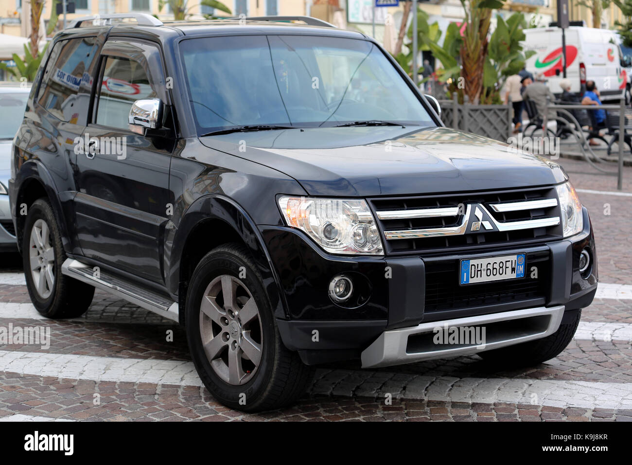 San Remo, Italy - October 16, 2016: Black Mitsubishi Pajero SUV Badly Parked in the Street of San Remo, Italia - Stock Image