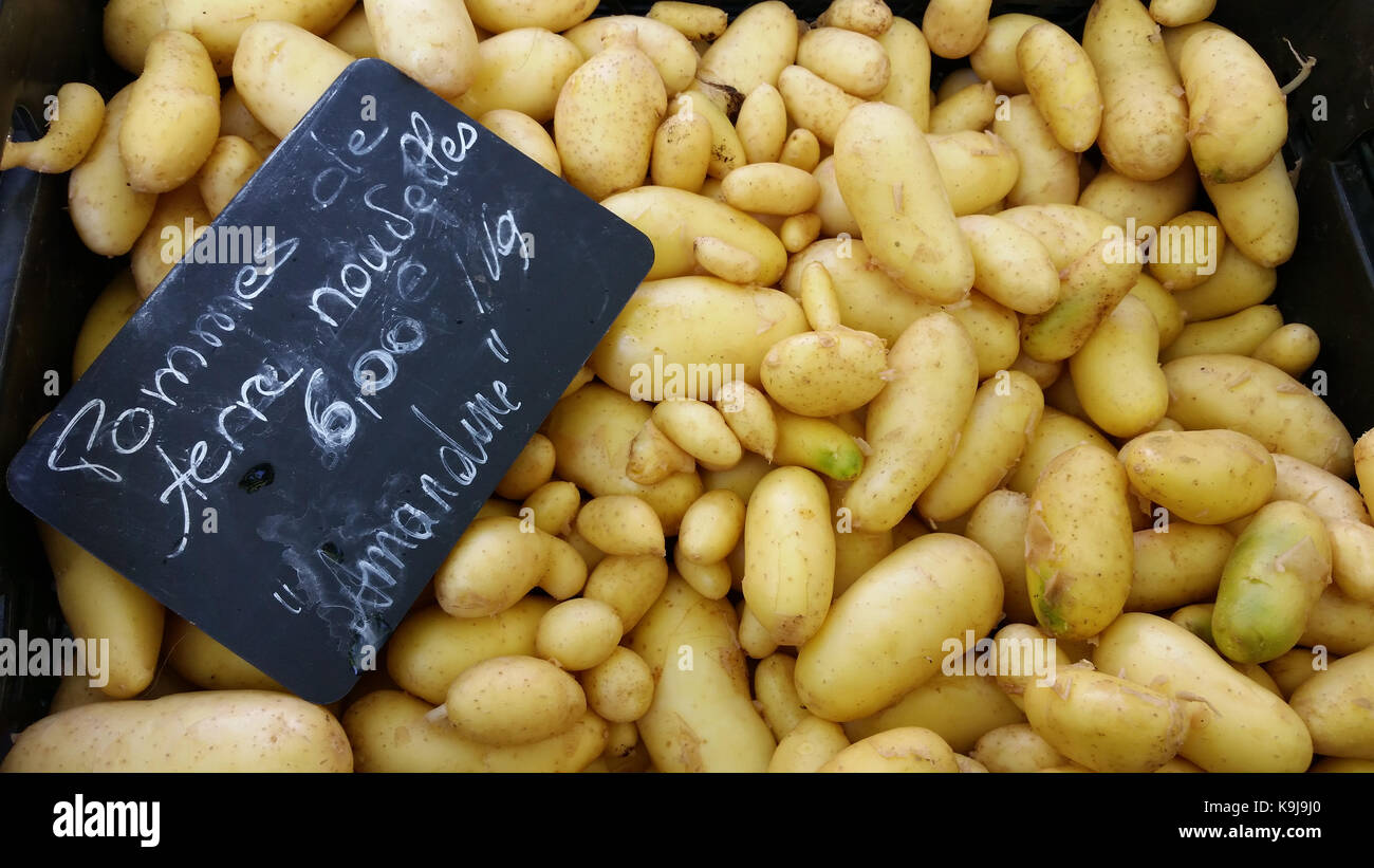 Potatoes for sale in vegetable market of Lyon in France. Marché Saint-Antoine Célestins - Stock Image