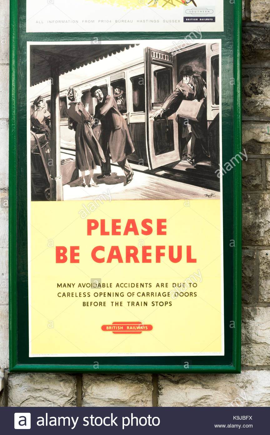 Please Be Careful, Old fifties style British Railways poster promoting safety on platforms.  Swanage steam railway - Stock Image