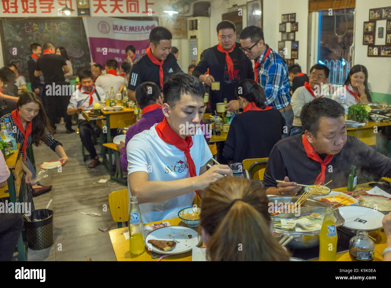 Beijing, China  23rd Sep, 2017. Chinese guests wear red scarves of Young Pioneers in a hot pot restaurant in Beijing, - Stock Image