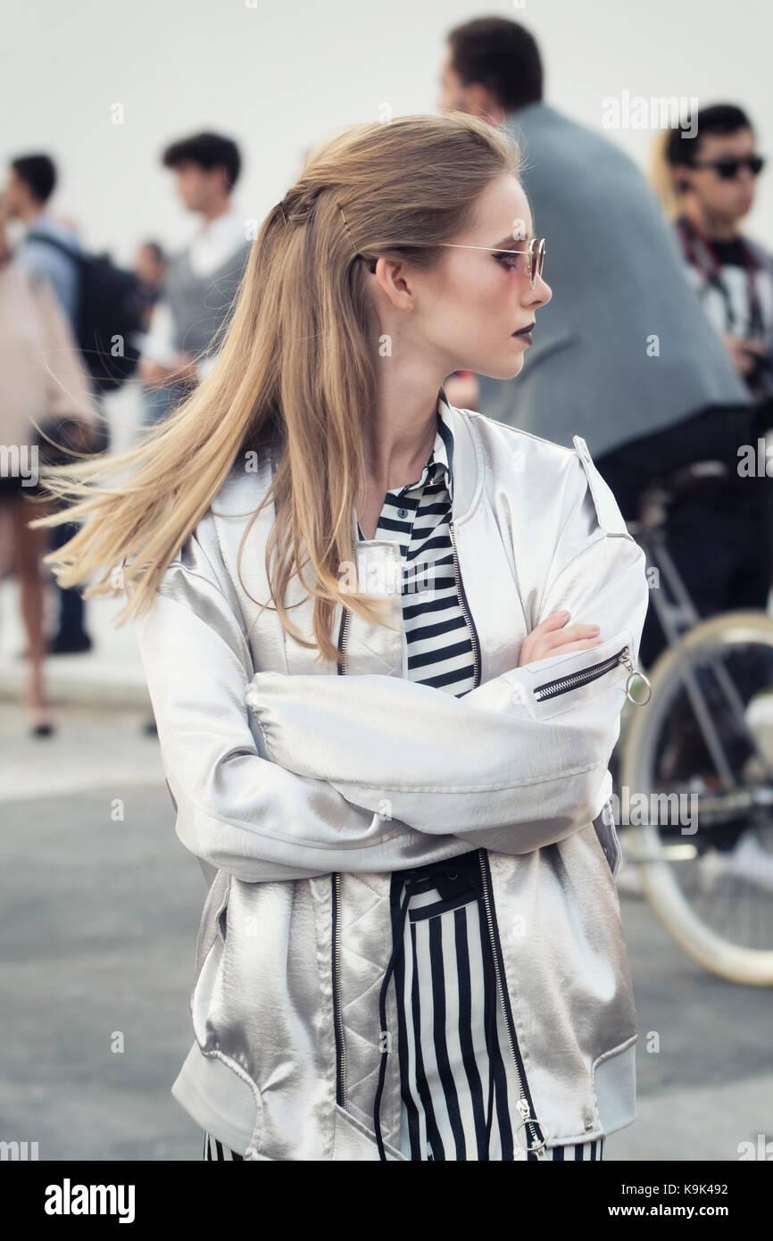 Milan, Italy. 23rd September, 2017,  Fashionable girl attending Jil Sander fashion show during Milan Fashion Week - Stock Image