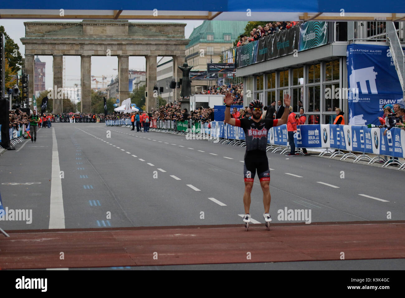 Berlin, Germany. 23rd September 2017. Second place Patxi Peula from Spain crosses the finishing line. Over 5,500 skater took part in the 2017 BMW Berlin Marathon Inline skating race, a day ahead of the  Marathon race. Bart Swings from Belgium won the race in 58:42 for the 5th year in a row. Credit: Michael Debets/Alamy Live News Stock Photo
