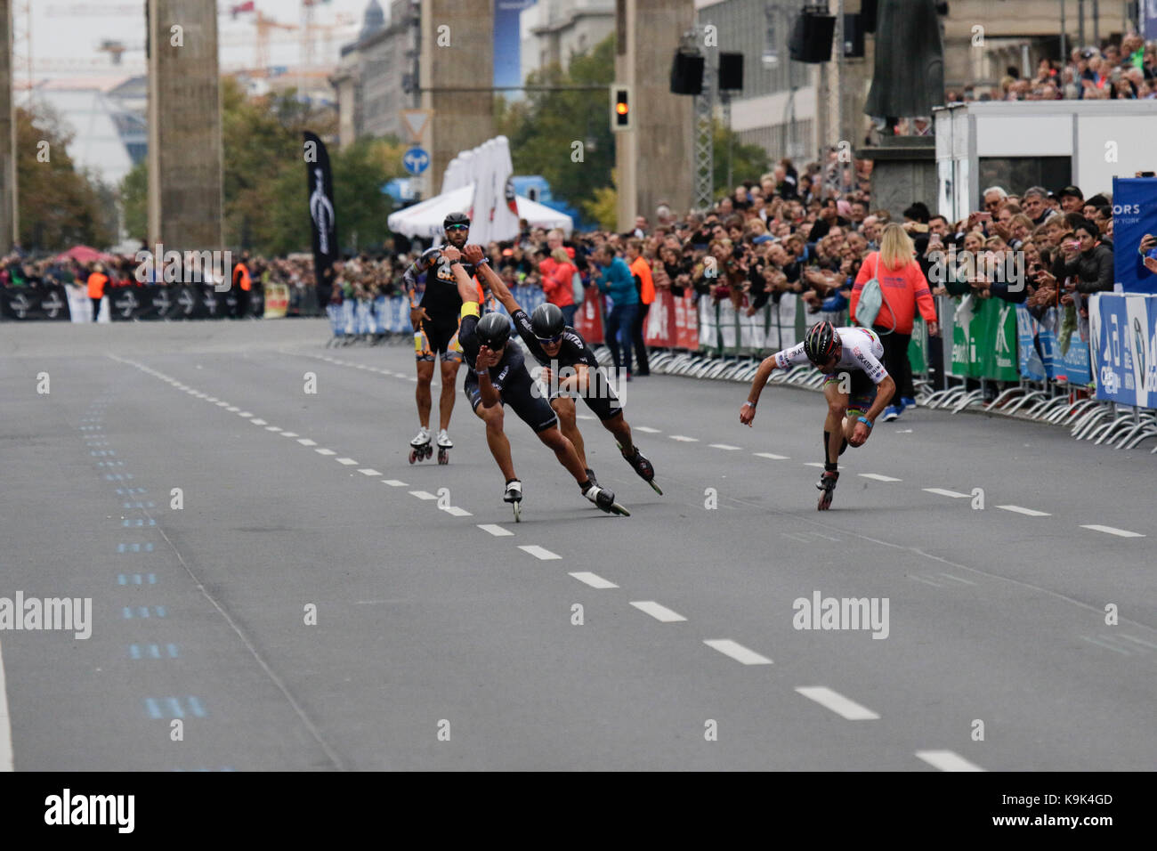 Berlin, Germany. 23rd September 2017. Second place Patxi Peula from Spain crosses the finishing line.Skaters race the last meters of the course from the Brandenburg Gate to the finishing line. Over 5,500 skater took part in the 2017 BMW Berlin Marathon Inline skating race, a day ahead of the  Marathon race. Bart Swings from Belgium won the race in 58:42 for the 5th year in a row. Credit: Michael Debets/Alamy Live News Stock Photo