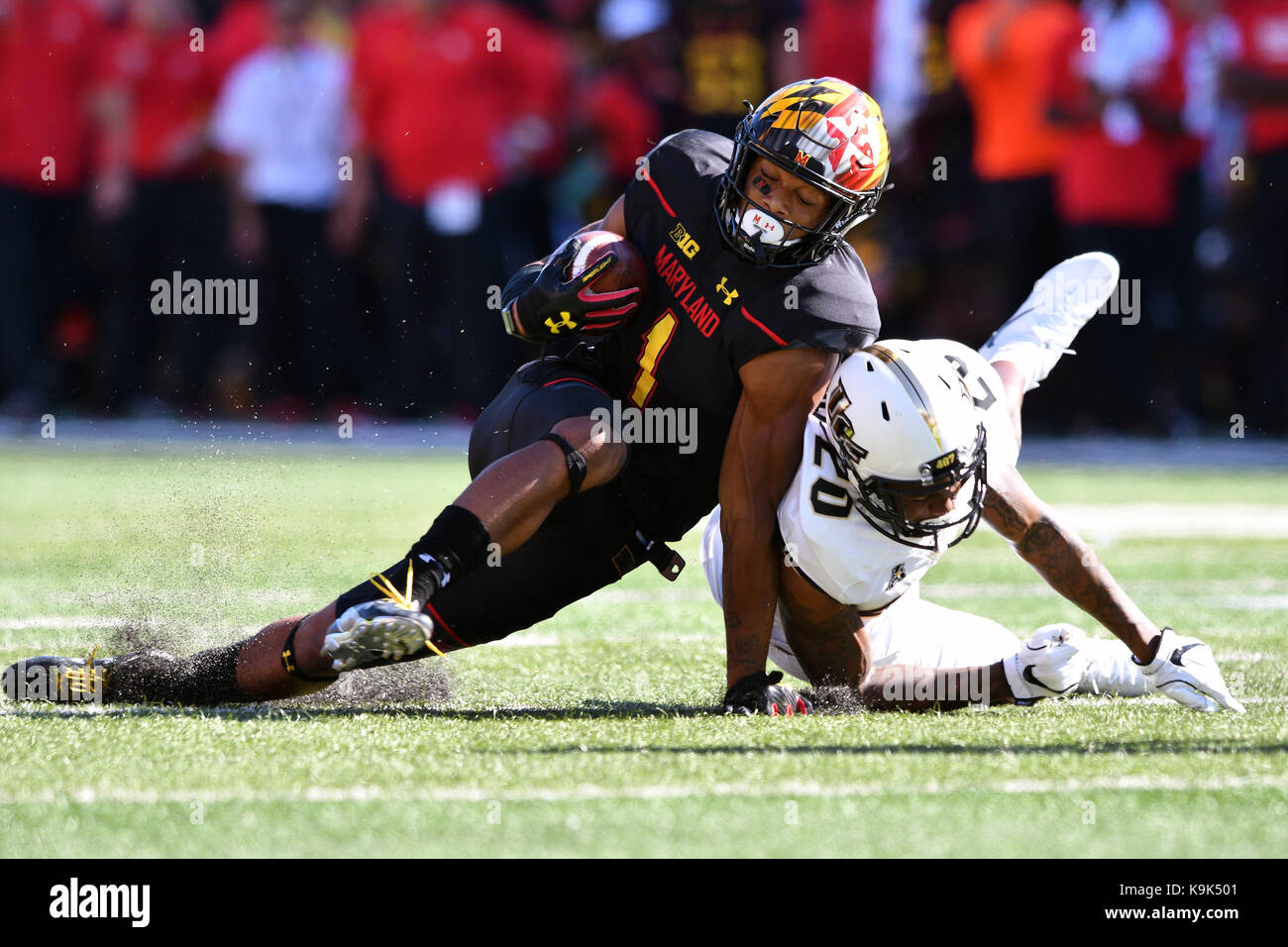 College Park, Maryland, USA. 23rd Sep, 2017. Maryland Terrapins wide receiver D.J. MOORE (1) is tackled by UCF Knights - Stock Image