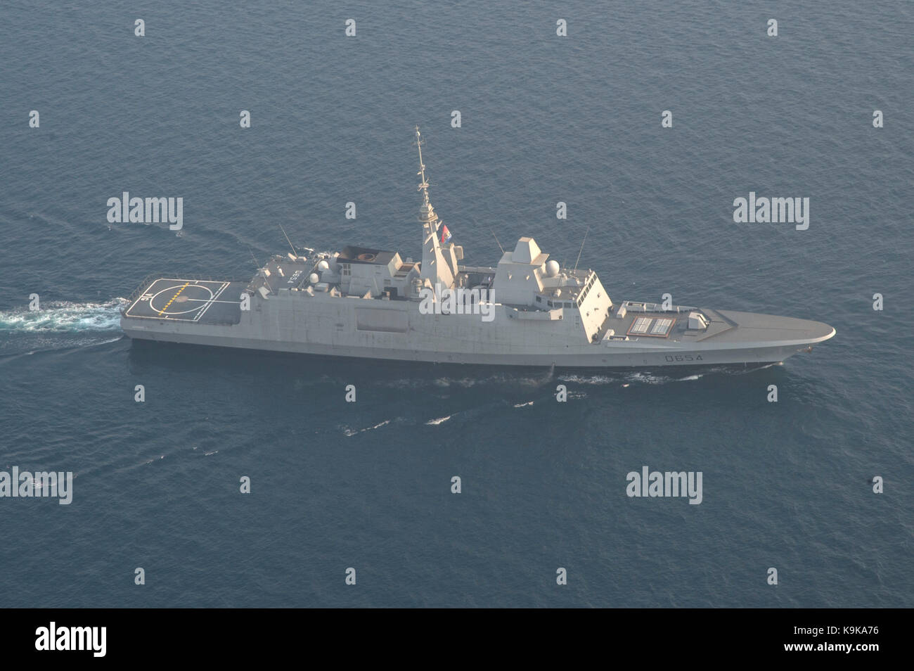 The French navy Cassard-class air defense destroyer Jean Bart (D615) transits the Arabian Gulf. - Stock Image