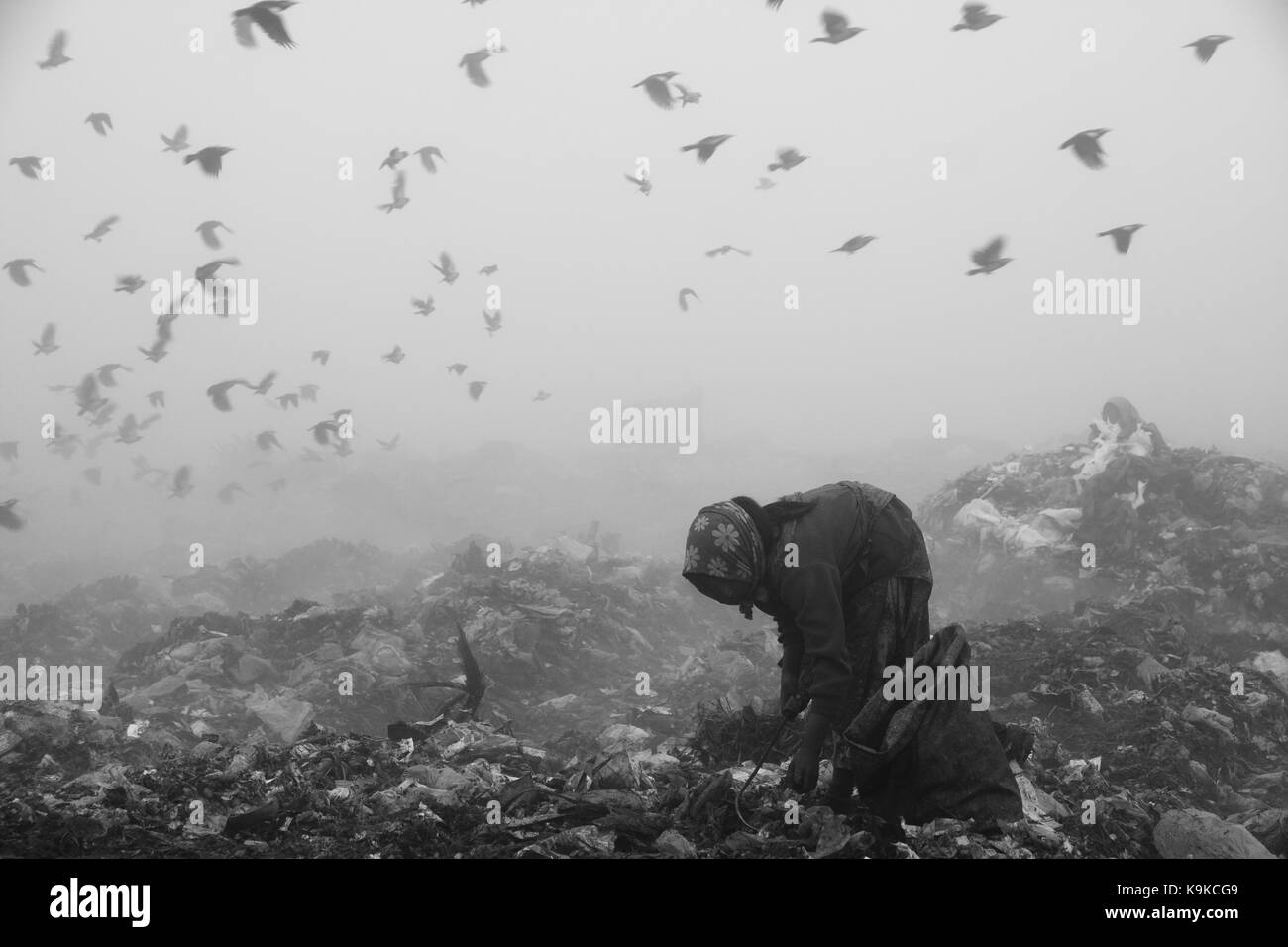 Life in a wasteland of nomadic people who make a living by picking recyclable waste materials such as plastic, broken - Stock Image