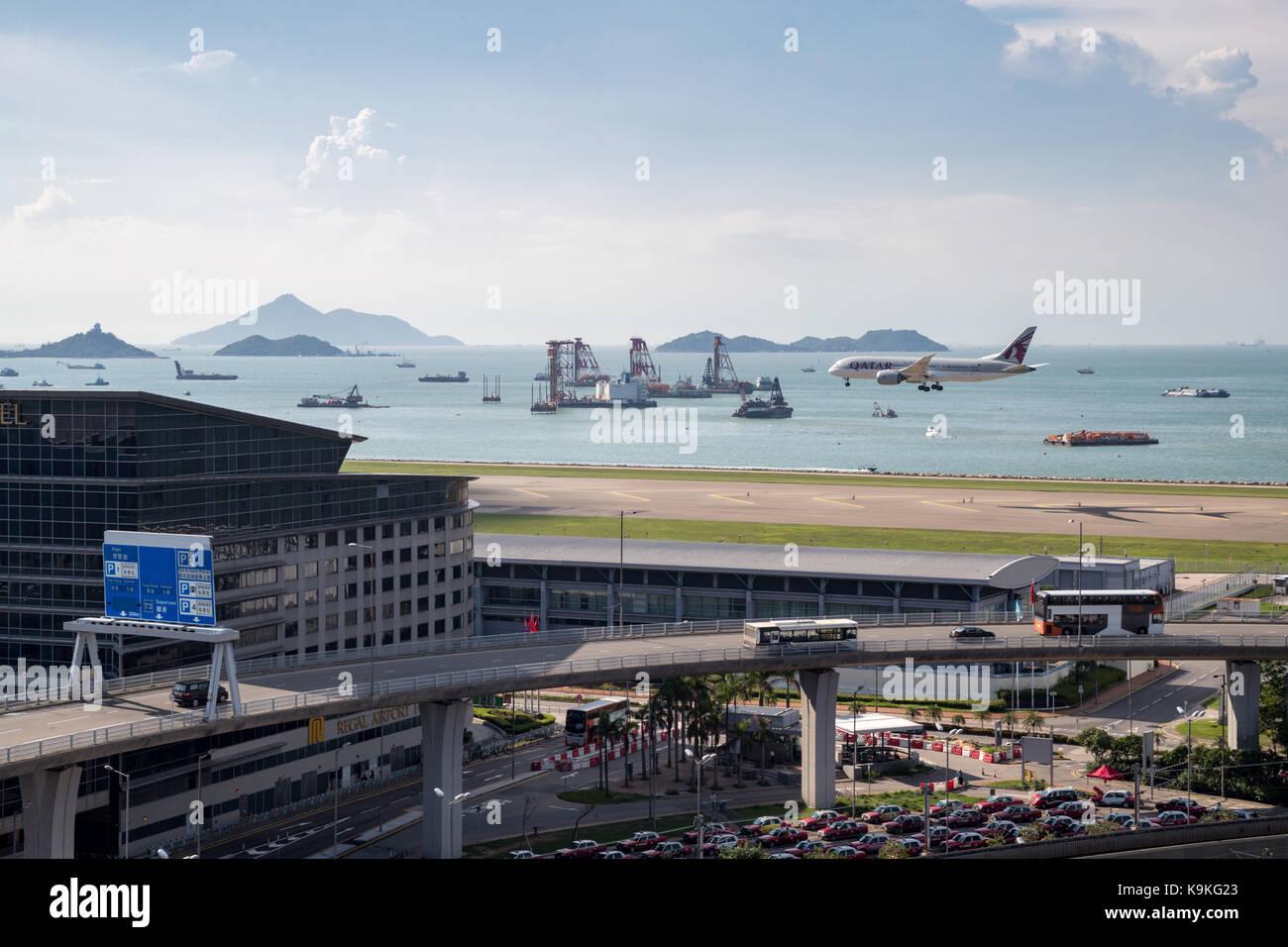 Lantau, Hong Kong  - September 10, 2017 :  Airplane landing at Hong Kong International Airport - Stock Image