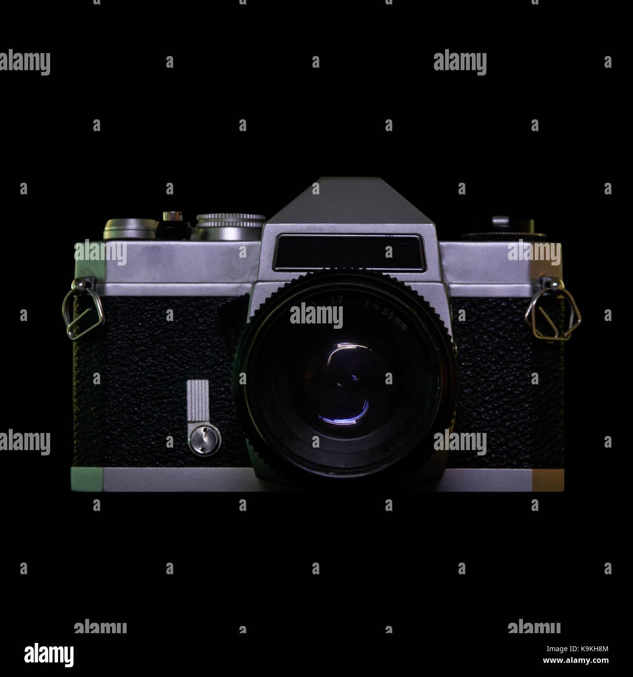 A vintage film camera on black background. - Stock Image