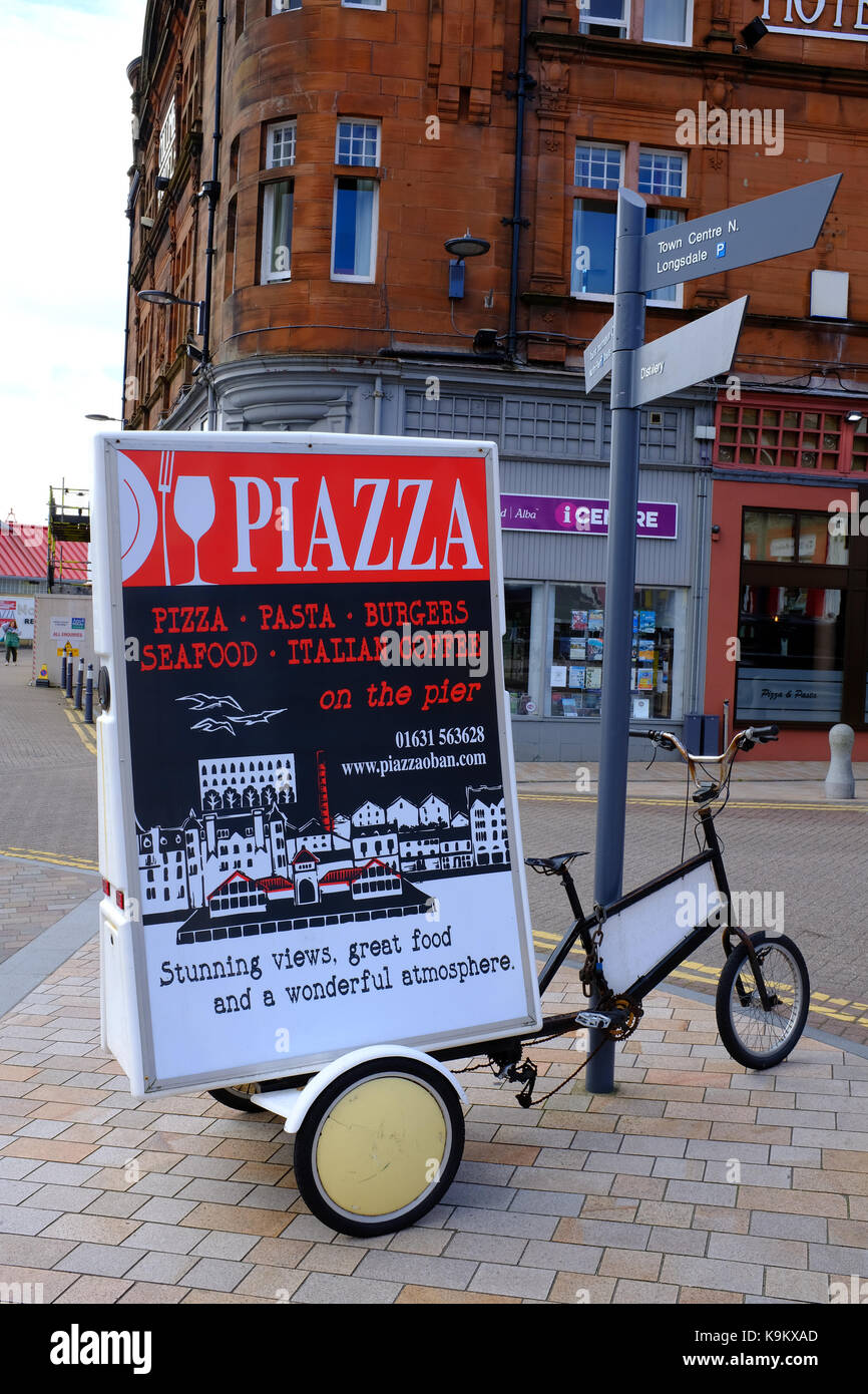 Restaurant advert on a bicycles in Oban - Scotland UK Stock Photo