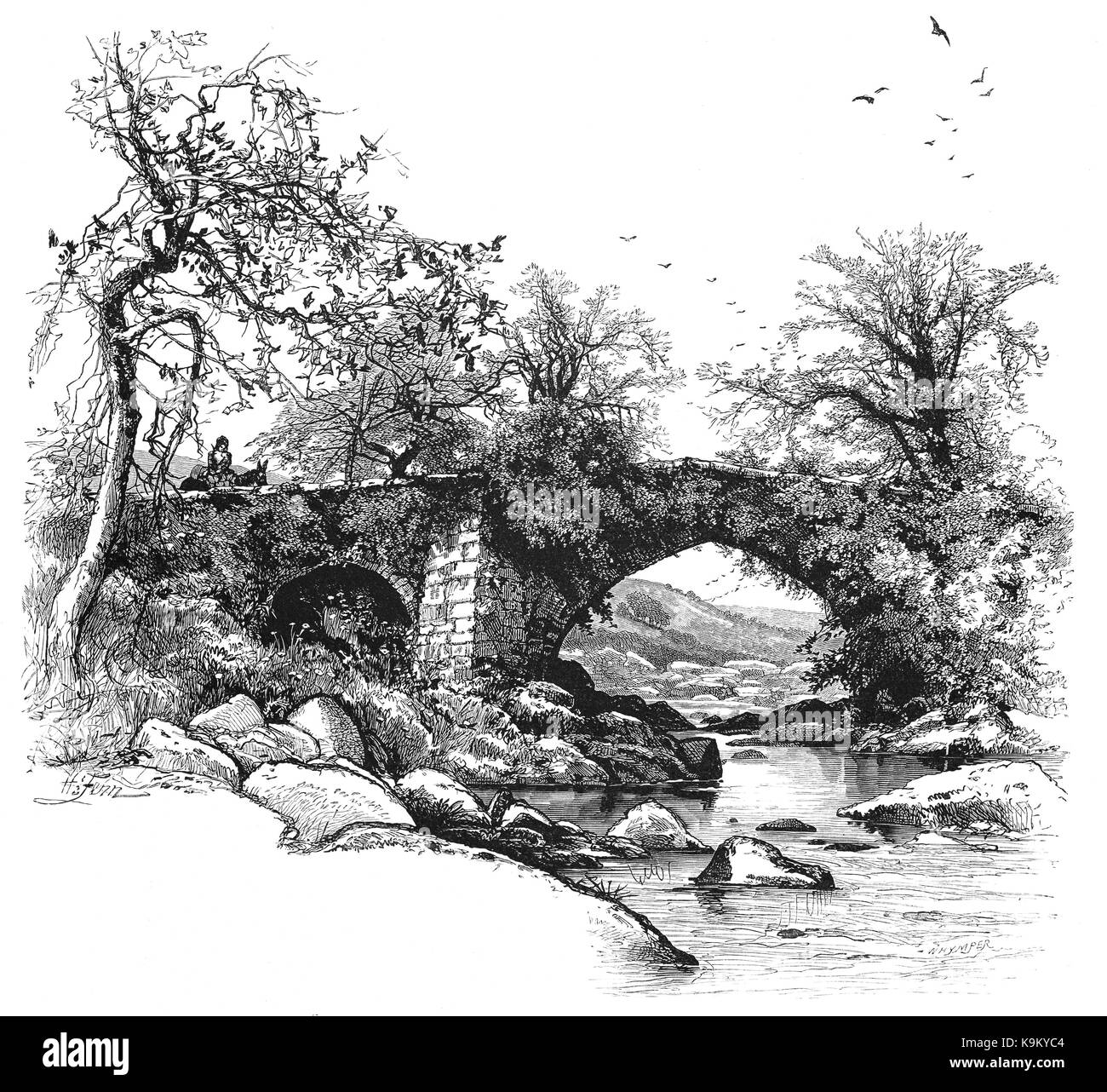 1870: A horserider crossing Harford Bridge crossing the River Erme, Dartmoor, Devon, England - Stock Image
