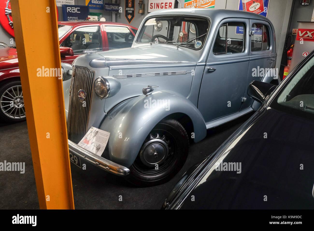 Vintage grey motorcar in workshop - Stock Image