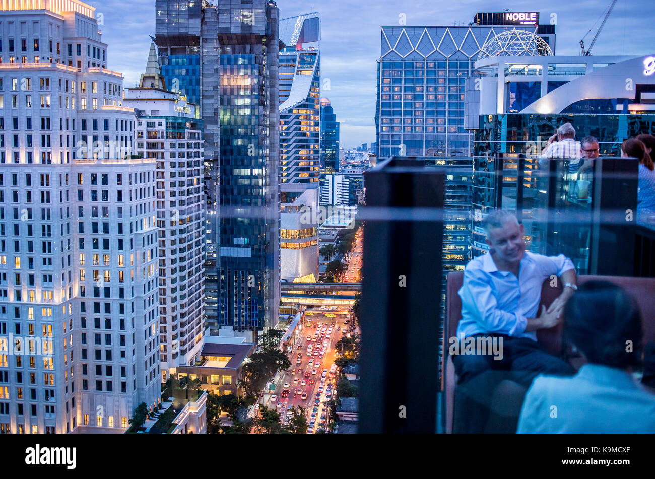View from Char Rooftop Bar at Indigo Hotel, Skyline and Wireless Road at night, downtown, Bangkok, Thailand - Stock Image