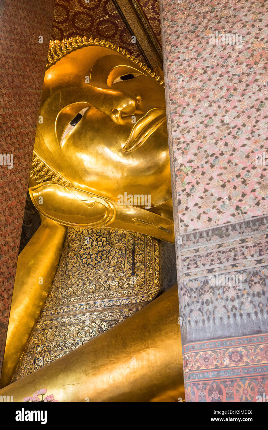 Golden big Buddha, in Wat Pho or Wat Phra Nakhon temple in Bangkok, Thailand - Stock Image